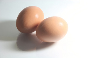 two eggs with hard shadow and reflection